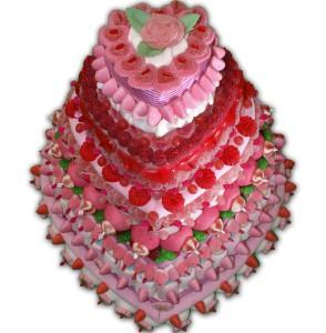 Pièce montée de plusieurs niveaux en bonbons roses